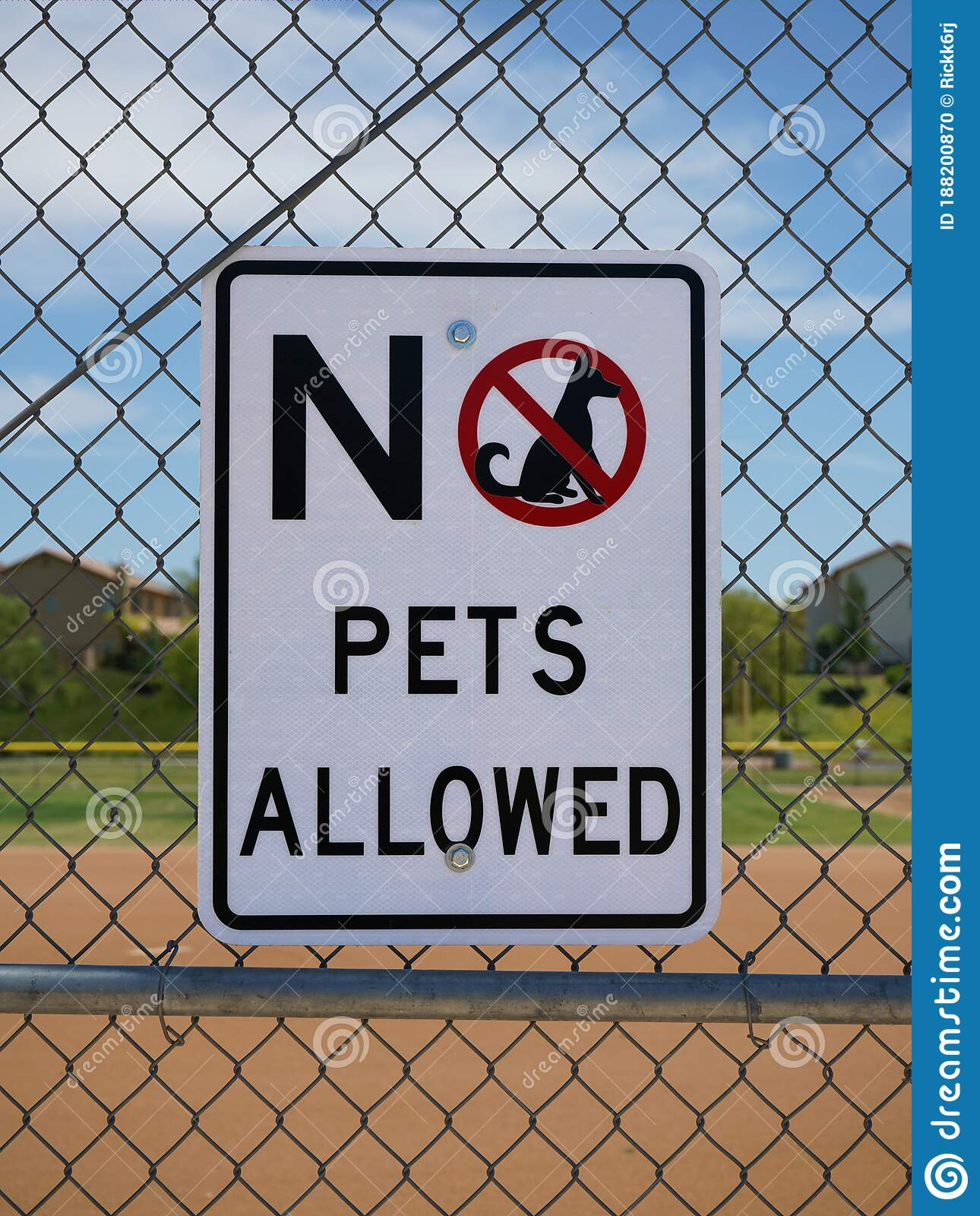 No Pets Allowed Sign On A Fence Stock Photo