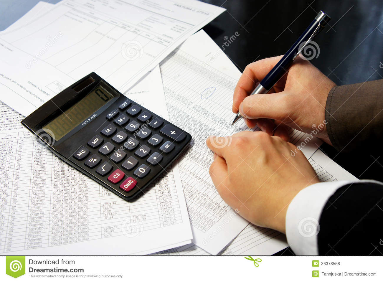 Office Table With Calculator Pen And Accounting Document