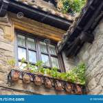 Old Brick House In The Village Facade Of Medieval Building With Flower Pots Checkered Window Roof Tiles And Exterior Decor Stock Image Image Of Architecture Pots 199134555