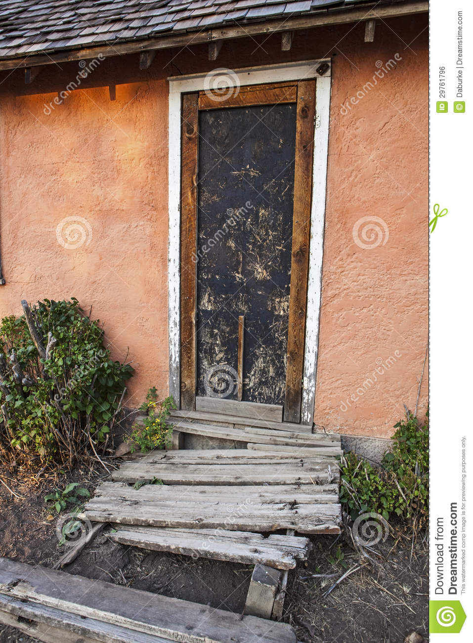 Old Stucco Cement House And Dilapidated Porch Stock Photo