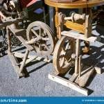 Old Vintage Wooden Spinning Wheels For Sale On The Street Fair Stock Photo Image Of Accessories Price 164268844