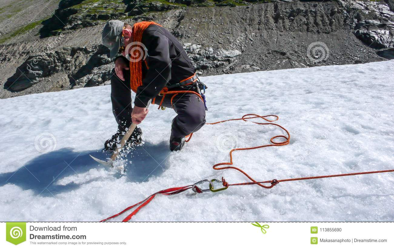 One Male Mountain Guide Installing A Pulley System For