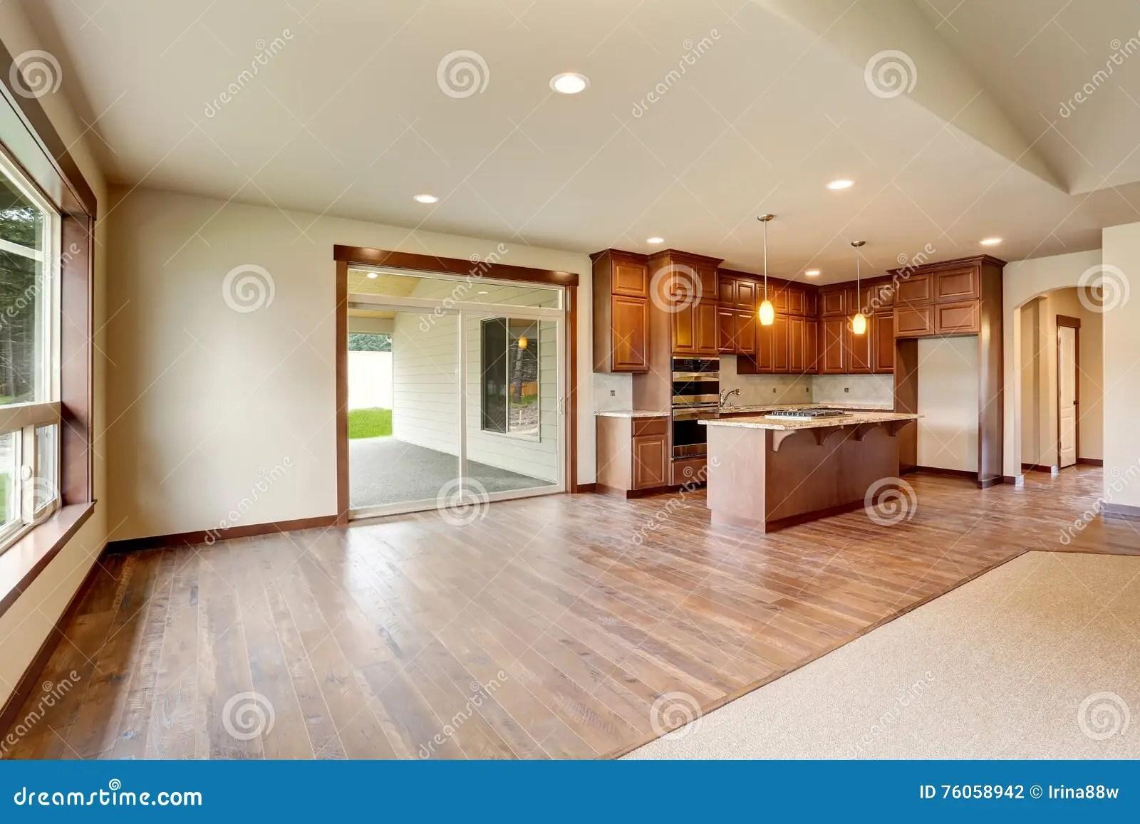 Open Floor Plan Empty Living Room With Carpet Floor