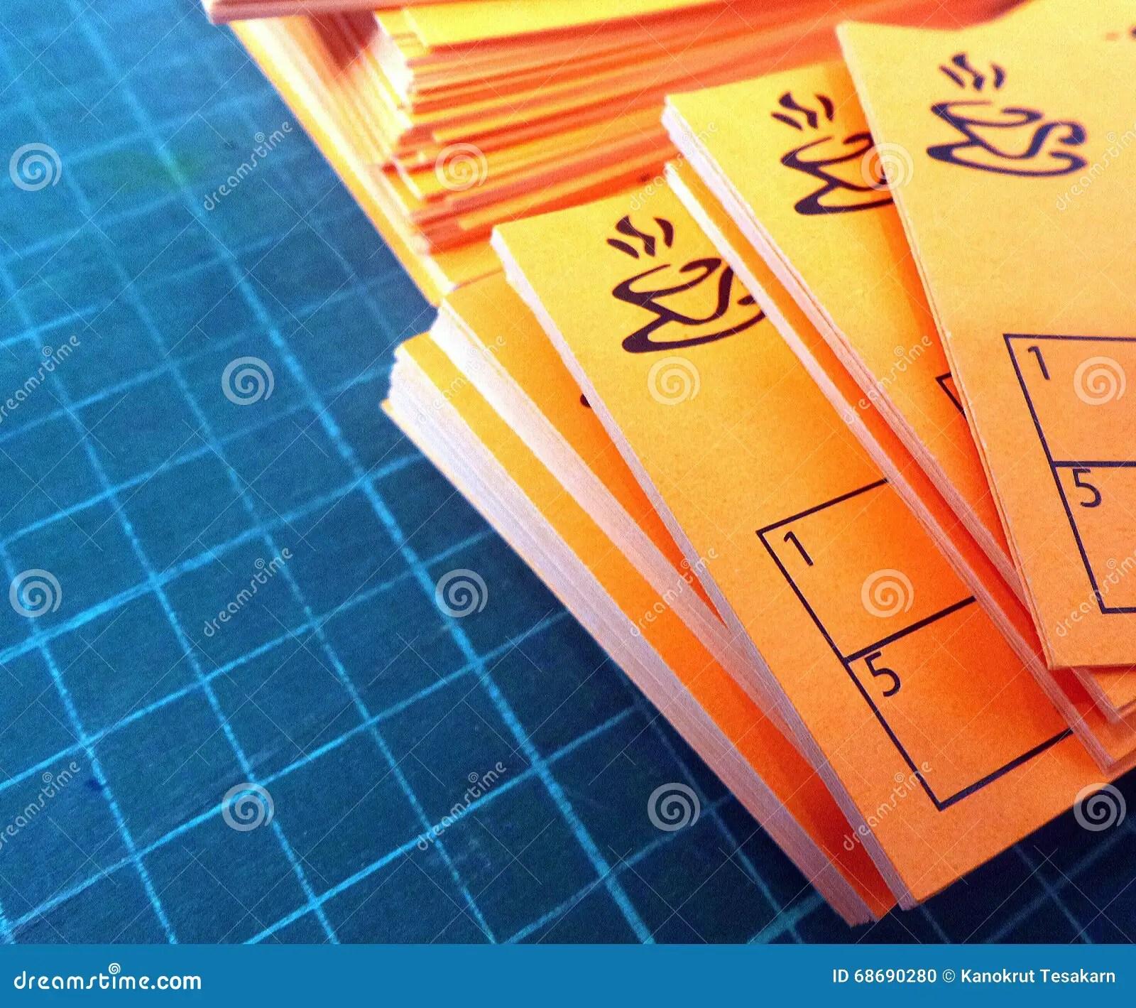 Orange Color Coffee Card On Green Cutting Mat Stock Photo