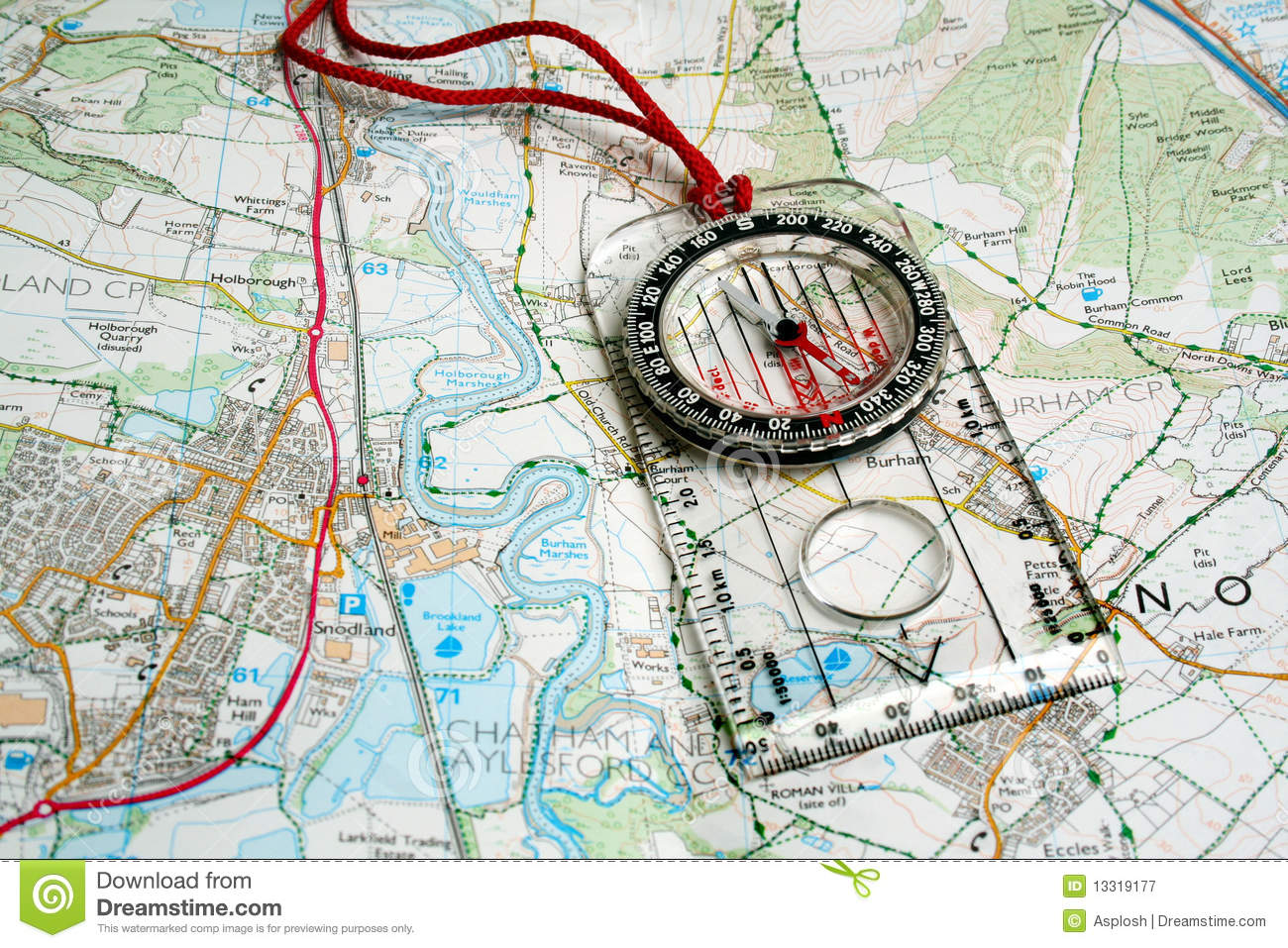 Orienteering Compass On A Map Royalty Free Stock