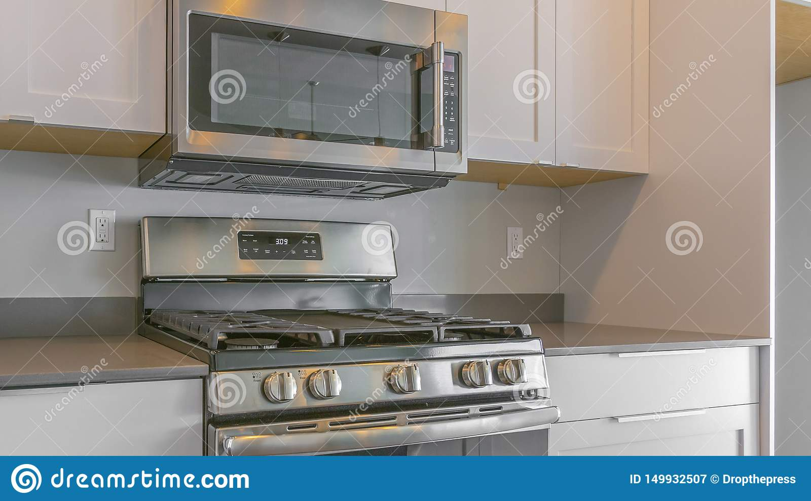 https www dreamstime com panorama cooking range wall mounted microwave inside modern kitchen white wooden cabinets built s light gray image149932507