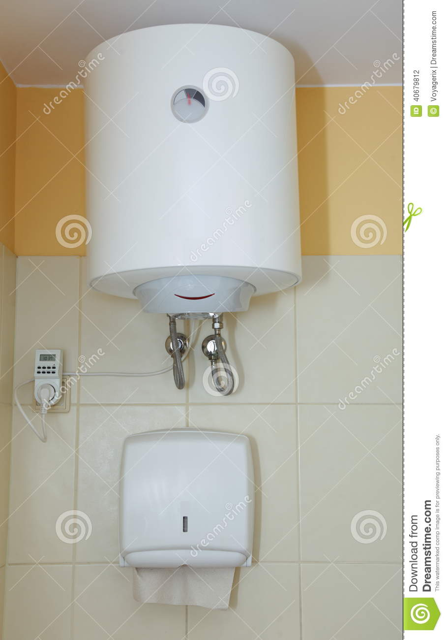 paper towel dispenser and electric water heater stock photo