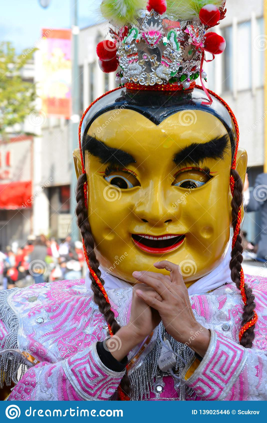 Performer In Mask And Costume At The Golden Dragon Parade
