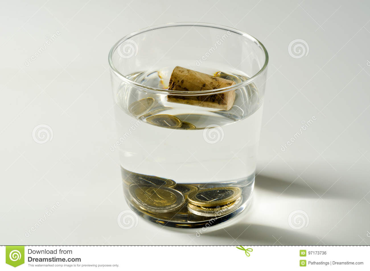 Physics Heavy And Light Objects In Water Stock Photo