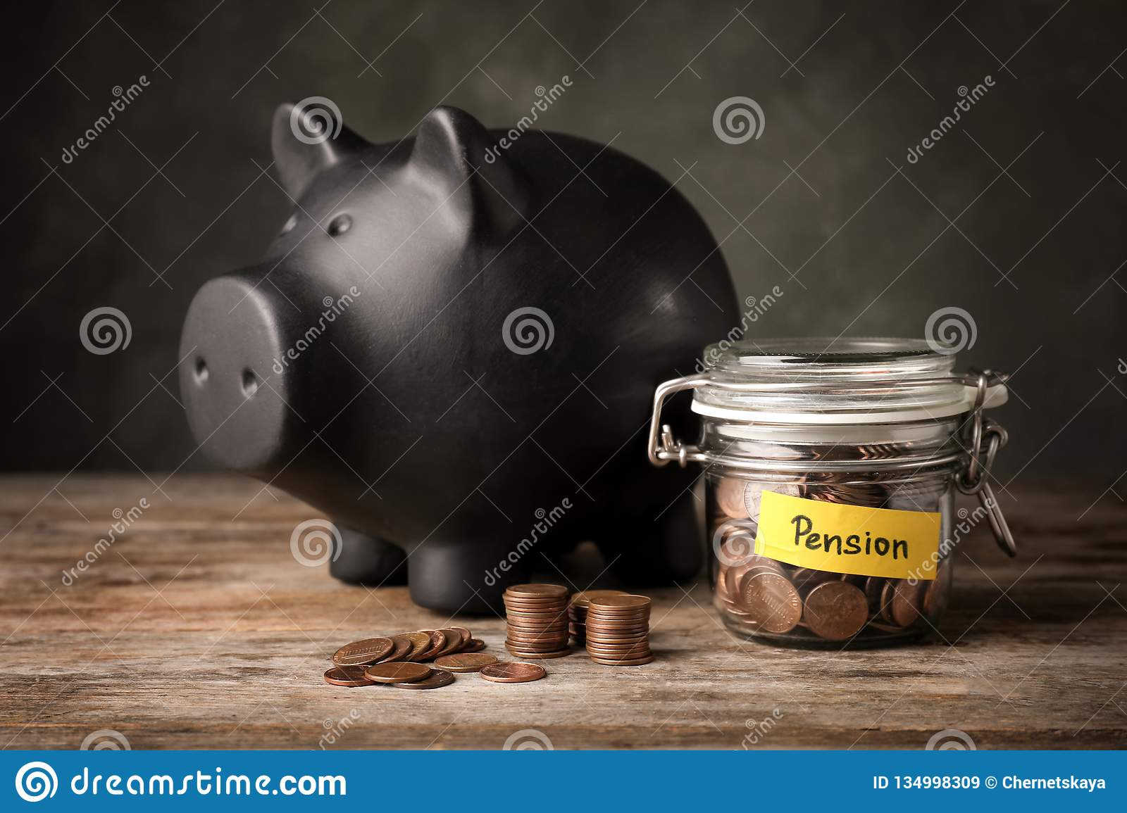 Piggy Bank And Jar Of Coins With Word Pension Stock Image