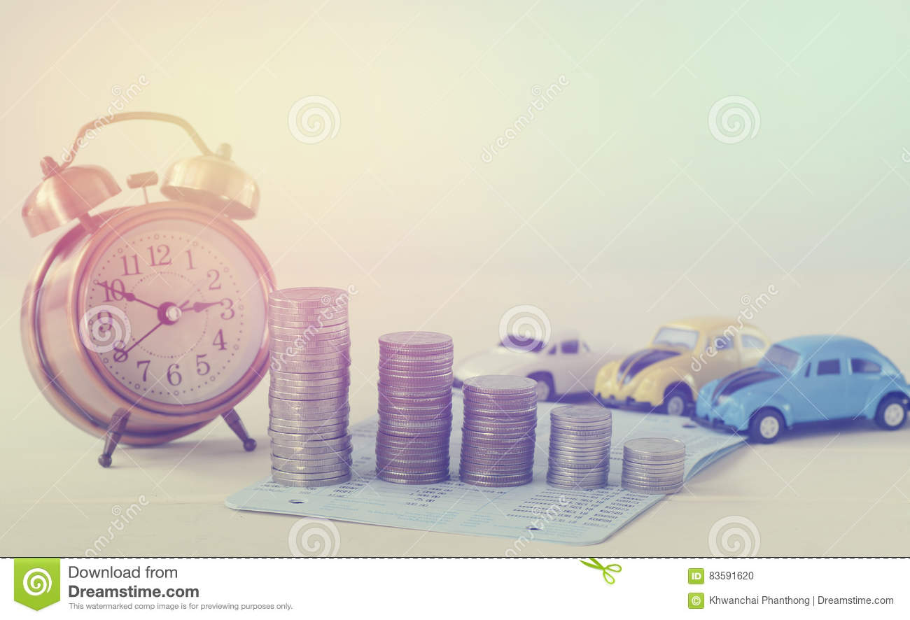 Pile Coins Money With Clock And Toy Cars Concept In Loan
