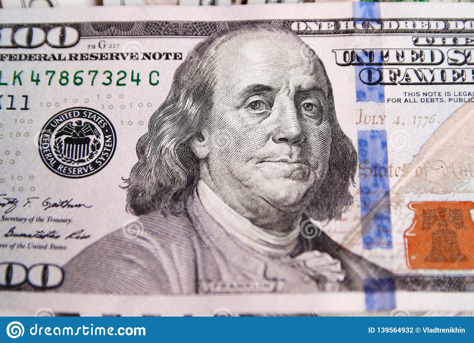 A Pile Of One Hundred Us Banknotes With President