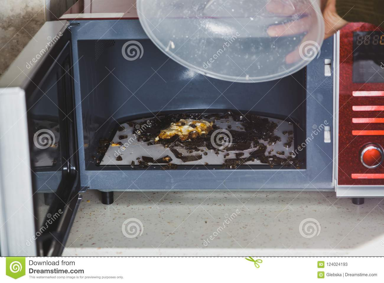 https www dreamstime com plate broke microwave oven heating glassware shattered small pieces hand lifts lid glass exploded image124024193