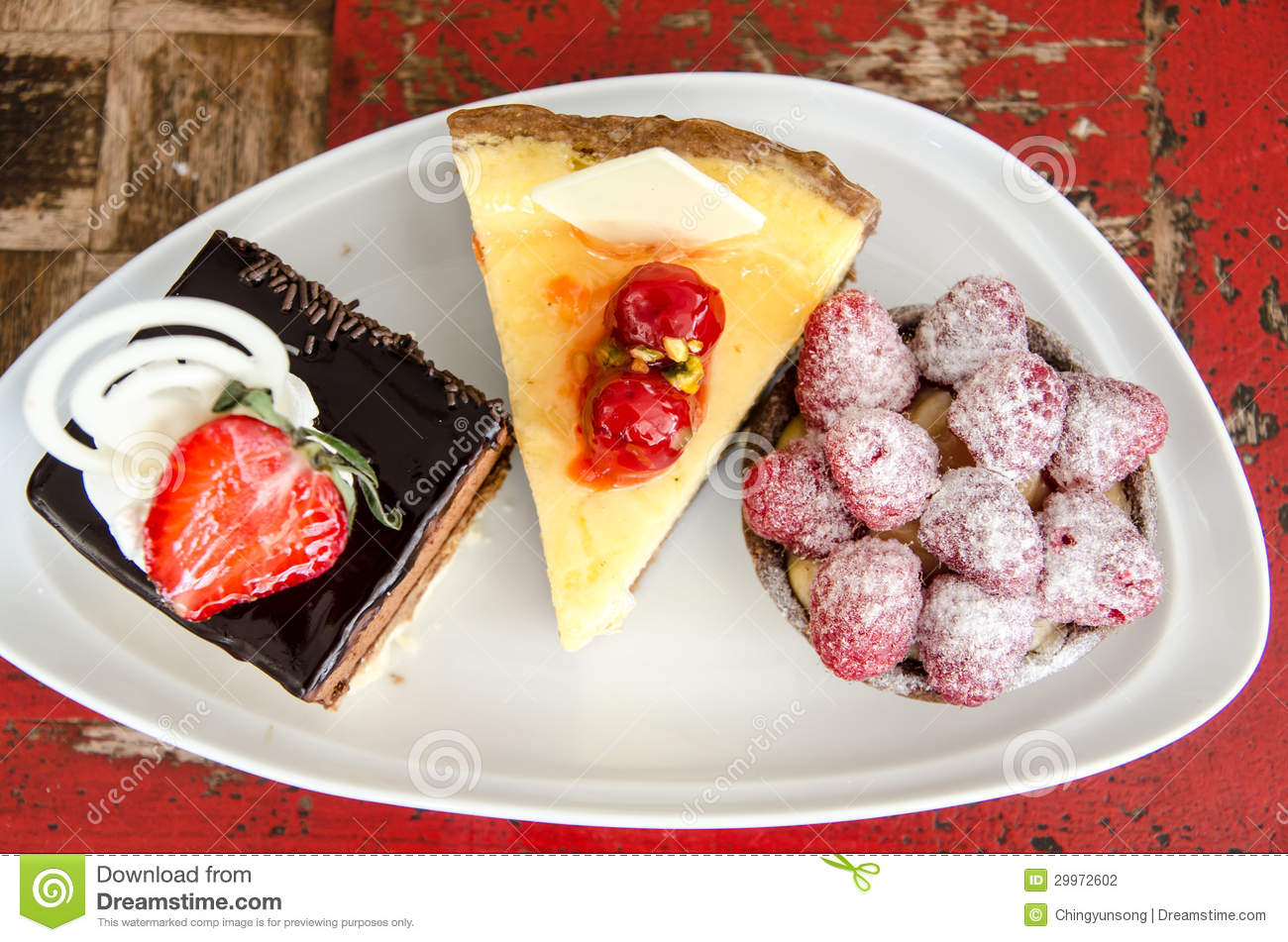 Plate With 3 Types Of Cakes Stock Photo Image Of Black