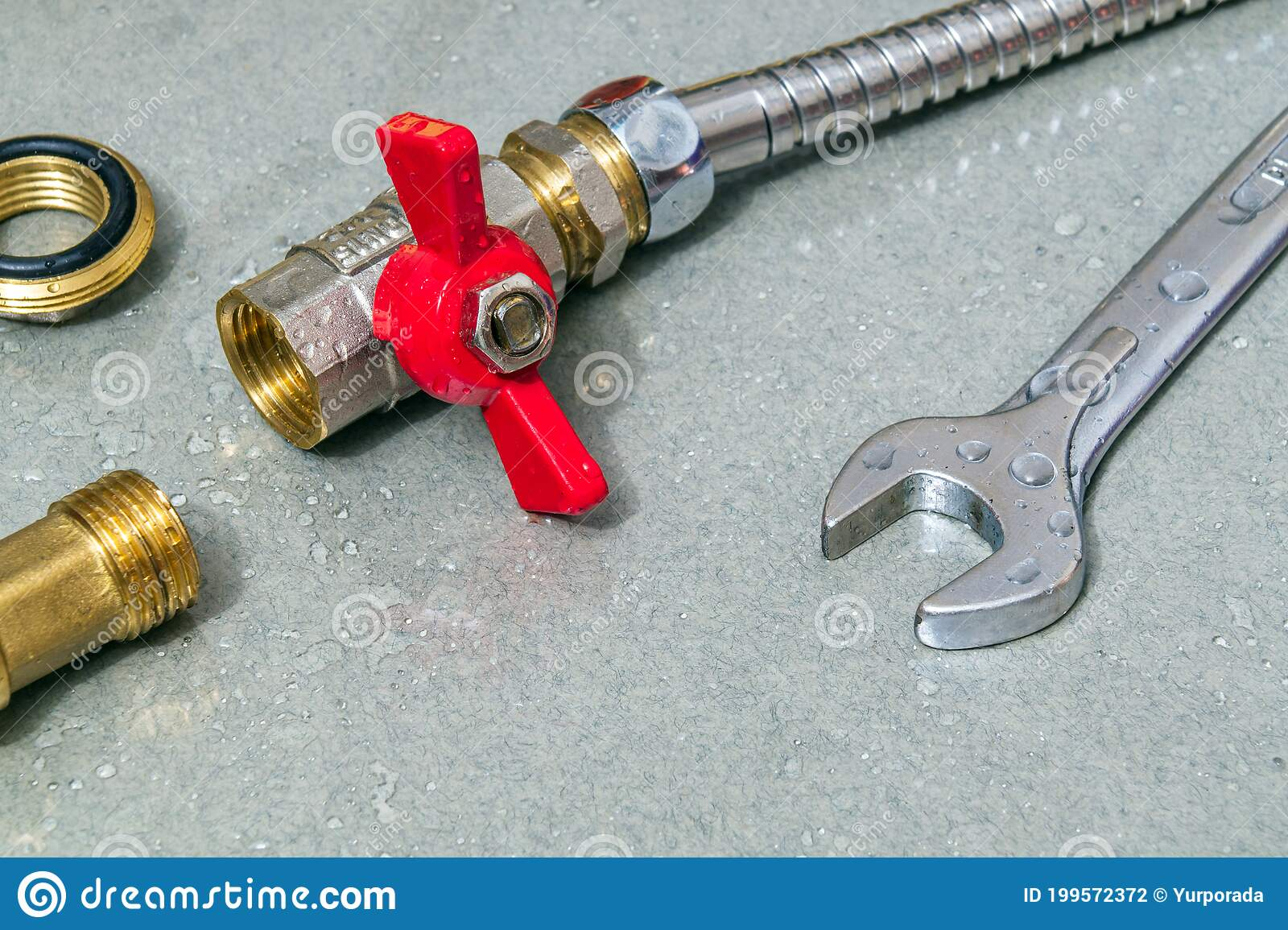 plumbing faucet and a wrench in water drops during equipment repair during an accident stock photo image of drops factory 199572372