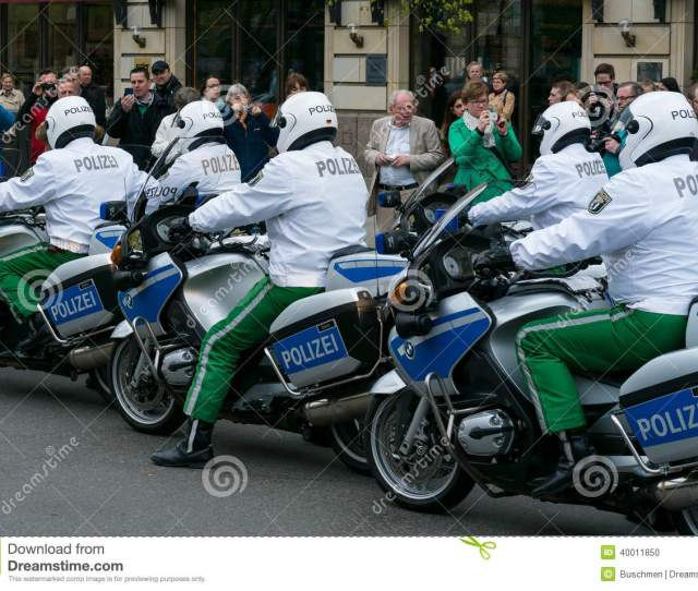 Berlin Germany April   Police Escort On Motorcycles Ensuring The Safety Of Vips