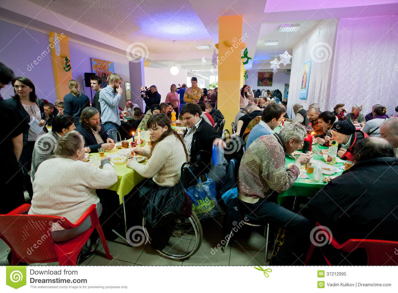 Poor People Sit Around Tables With Food At The Christmas