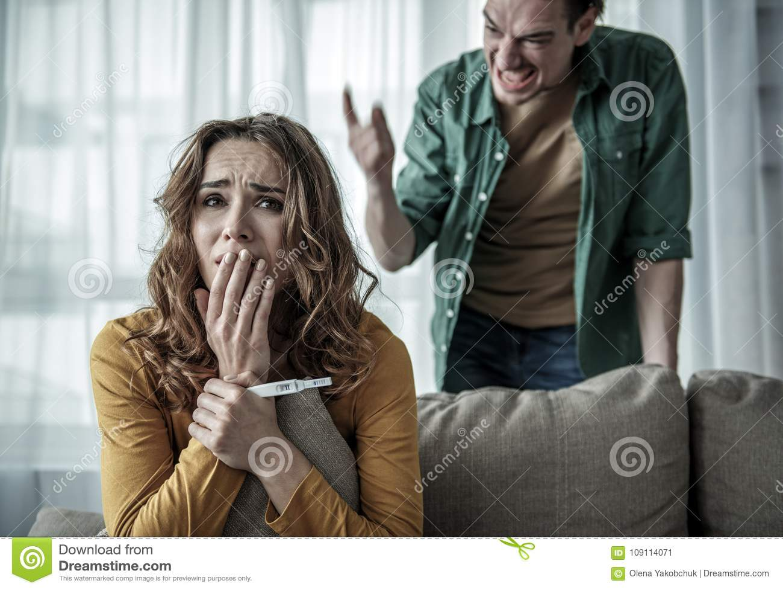 Irritated Man Shouting At Pregnant Woman Stock Image