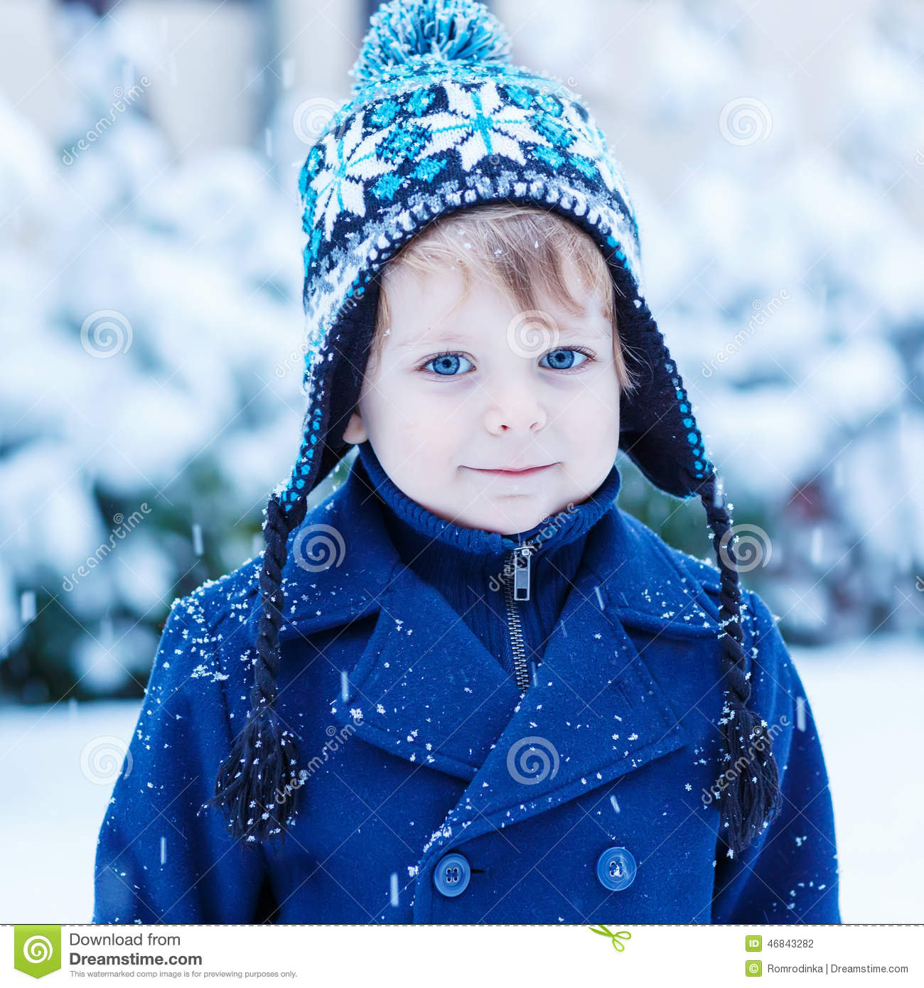 Portrait Of Little Toddler Boy In Winter Clothes With