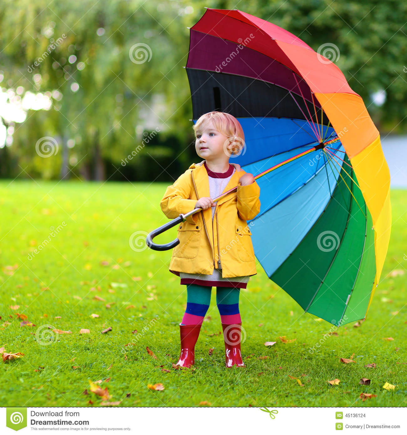 Portrait Of Small Preschooler Girl With Colorful Umbrella