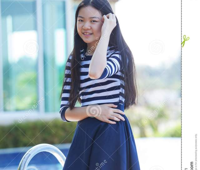Portrait Of Young Asian Teen Smiling Face Happiness Emotion At H
