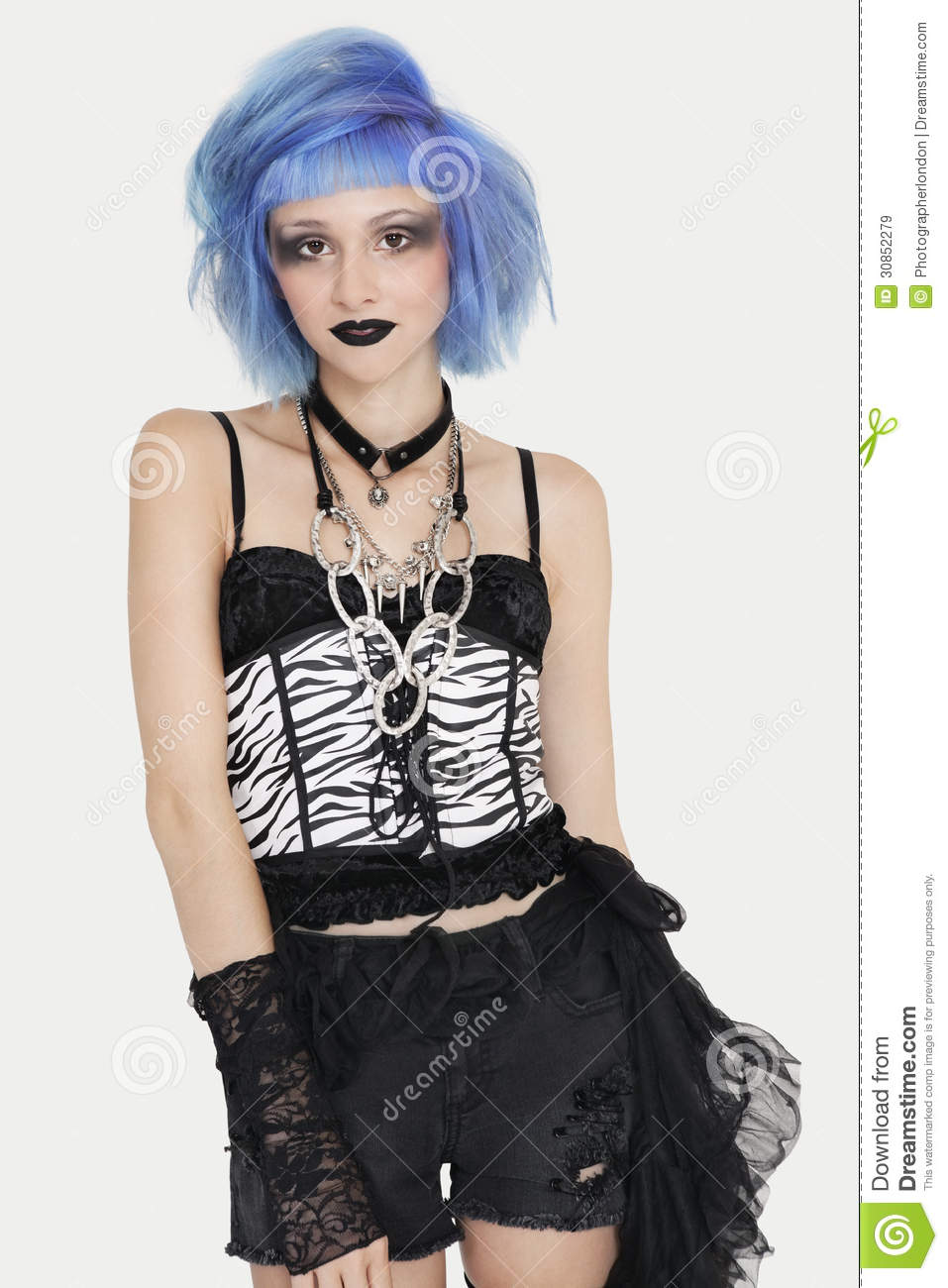 Portrait Of Young Female Punk With Dyed Hair Over Gray