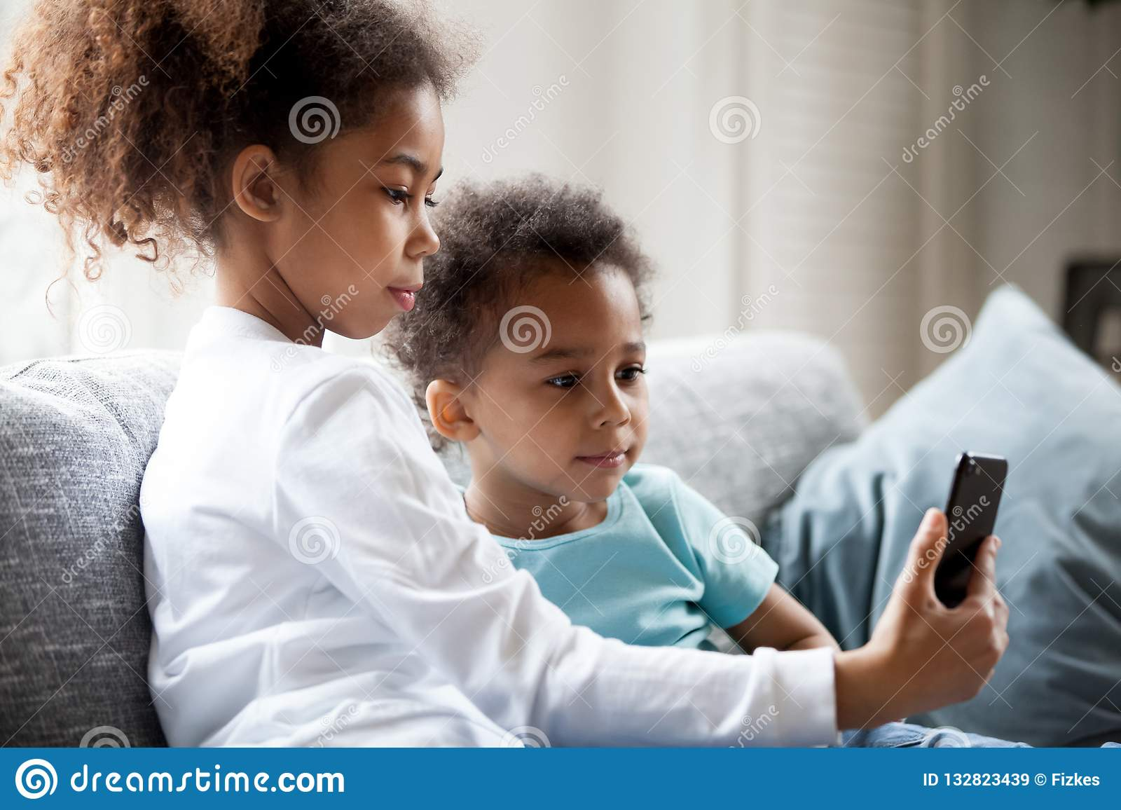 Pretty African American Children Is Using Smartphone Stock