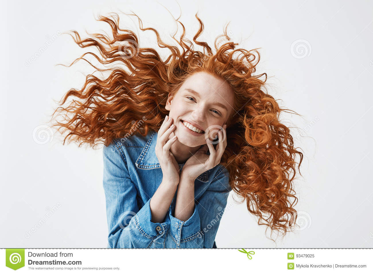 Pretty Cheerful Redhead Girl With Flying Curly Hair