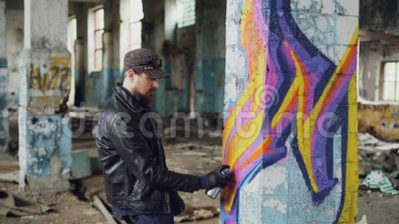 Professional Graffiti Painter Is Creating Abstract Image On Large