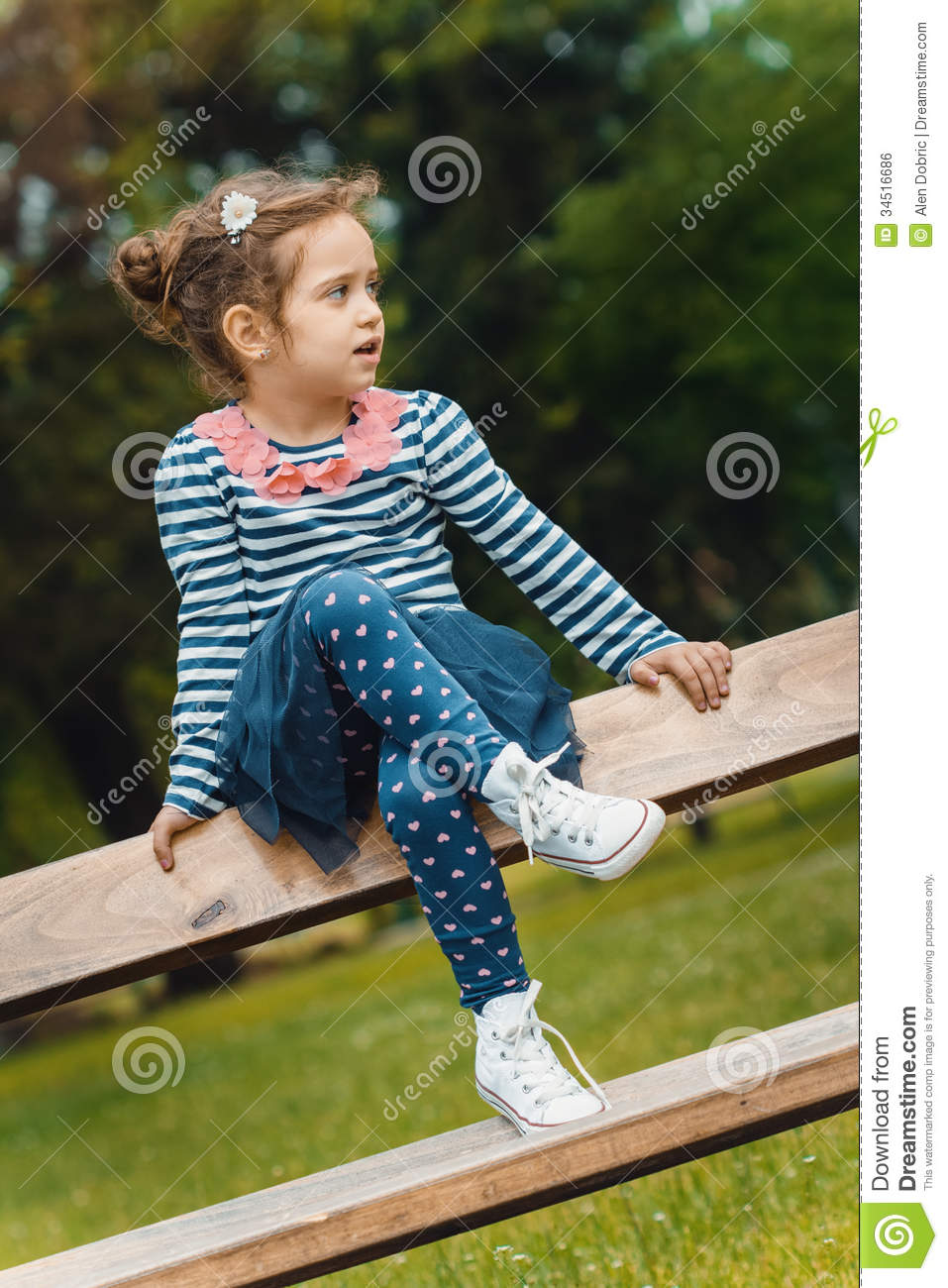 Profile Of Cute Little Girl In A Park Royalty Free Stock