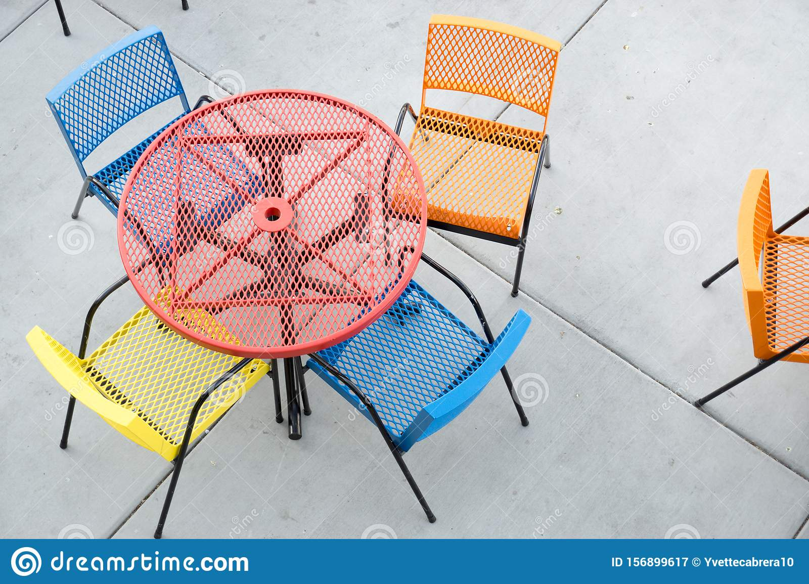 https www dreamstime com red orange yellow blue outdoor table colorful restaurant chairs outside cement patio daytime image156899617