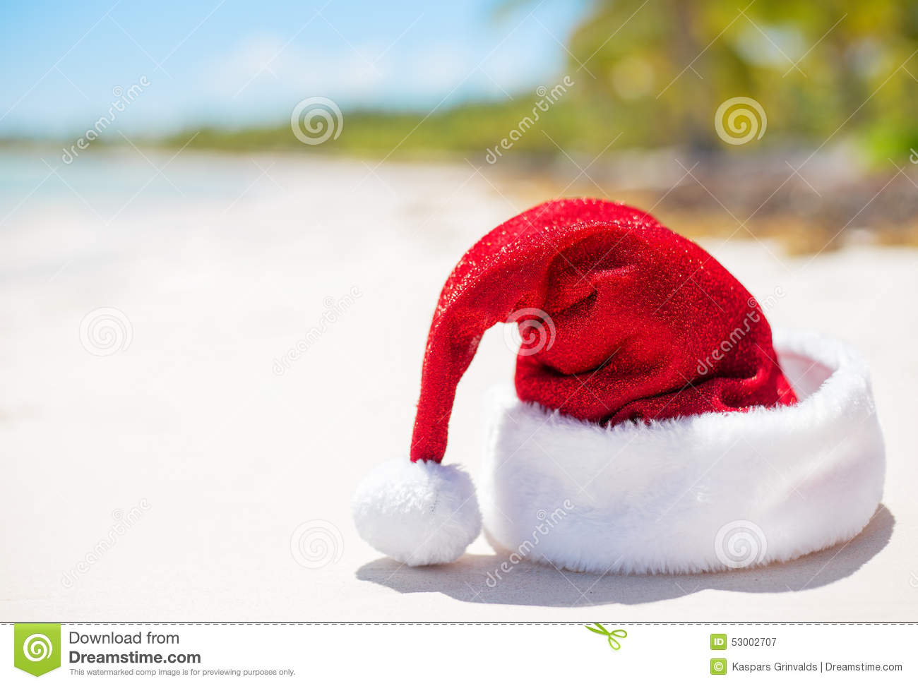 Red Santa Claus Hat On Beach Theme For Christmas Vacation