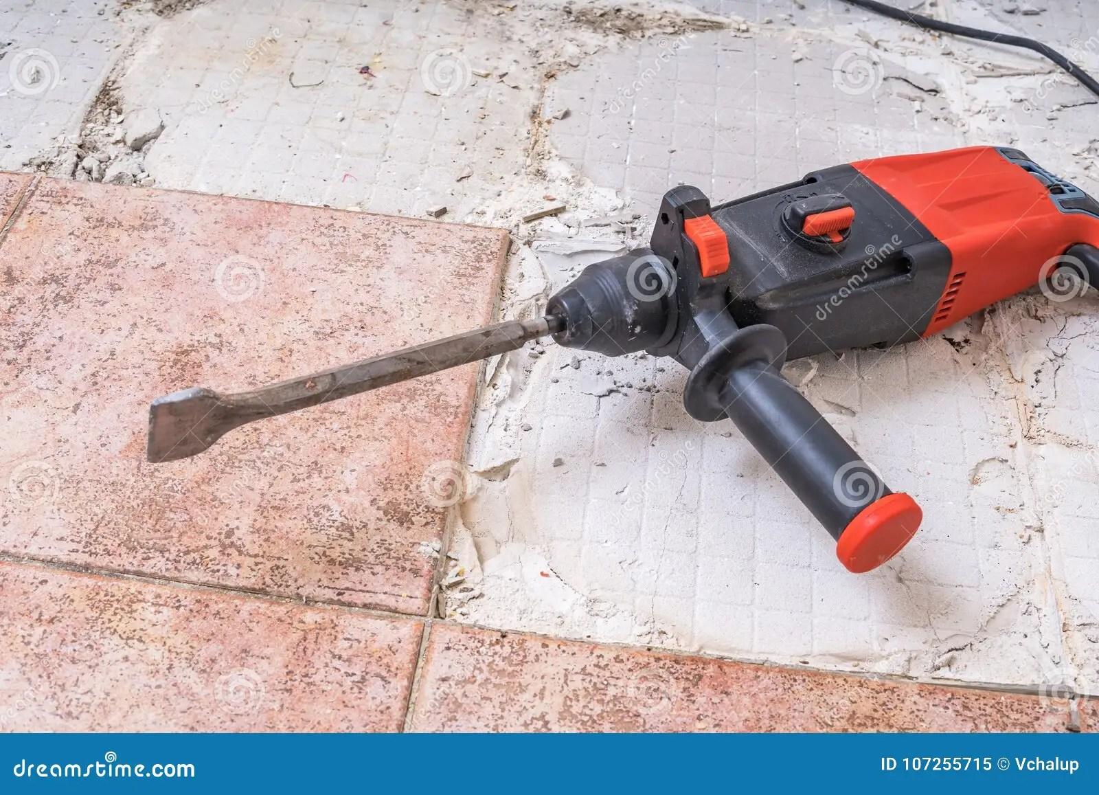 https www dreamstime com removing old tiles jackhammer drilling demolition hammer floor removing old tiles jackhammer drilling demolition hammer image107255715