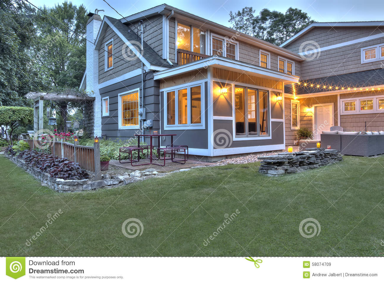 Resored Cape Cod Home At Dusk Stock Image