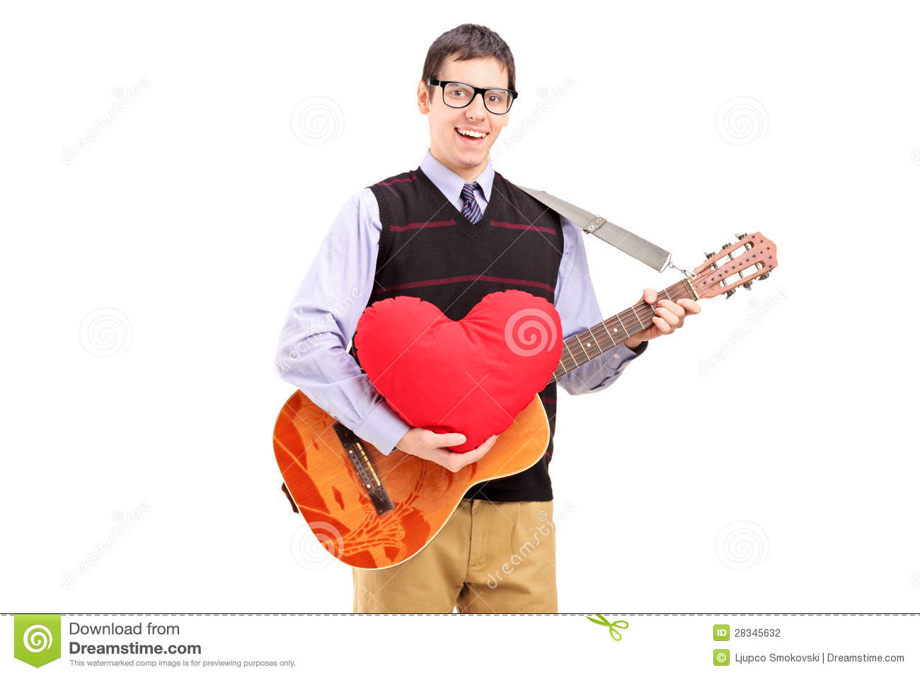 Romantic Young Man Playing An Acoustic Guitar And Holding