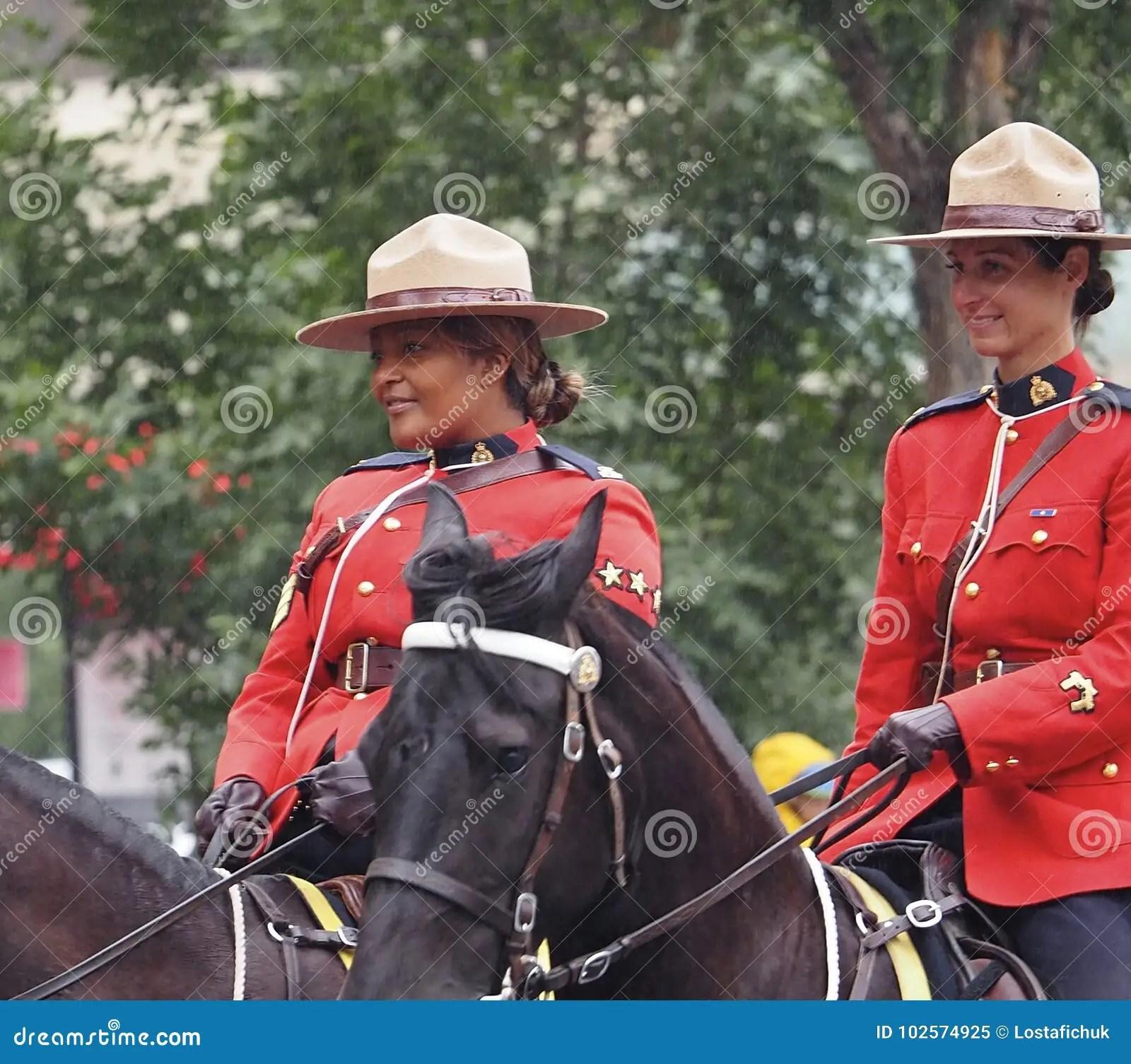 Royal Canadian Mounted Police On Horseback Editorial Image