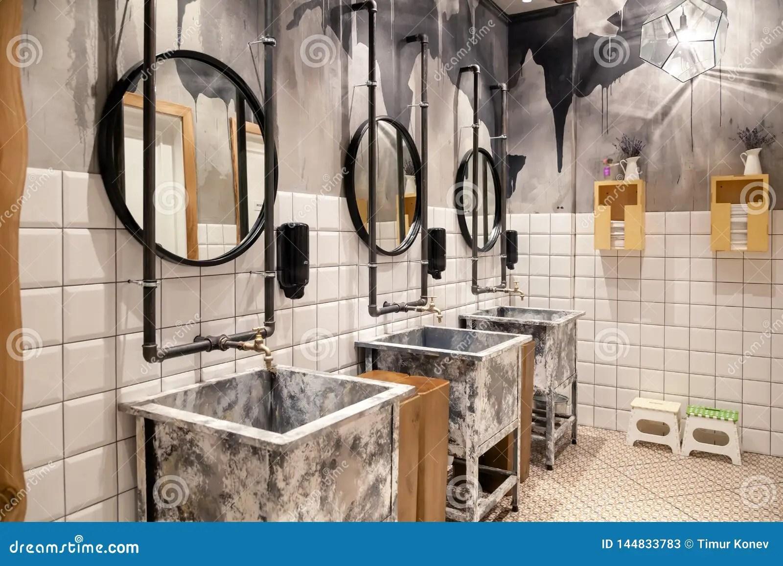 https www dreamstime com russia novosibirsk modern interior restaurant loft style toilet square concrete sinks copper faucet black russia novosibirsk image144833783
