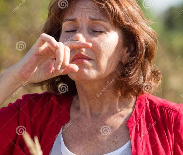 S Woman Having Hay Fever Allergies In Countryside