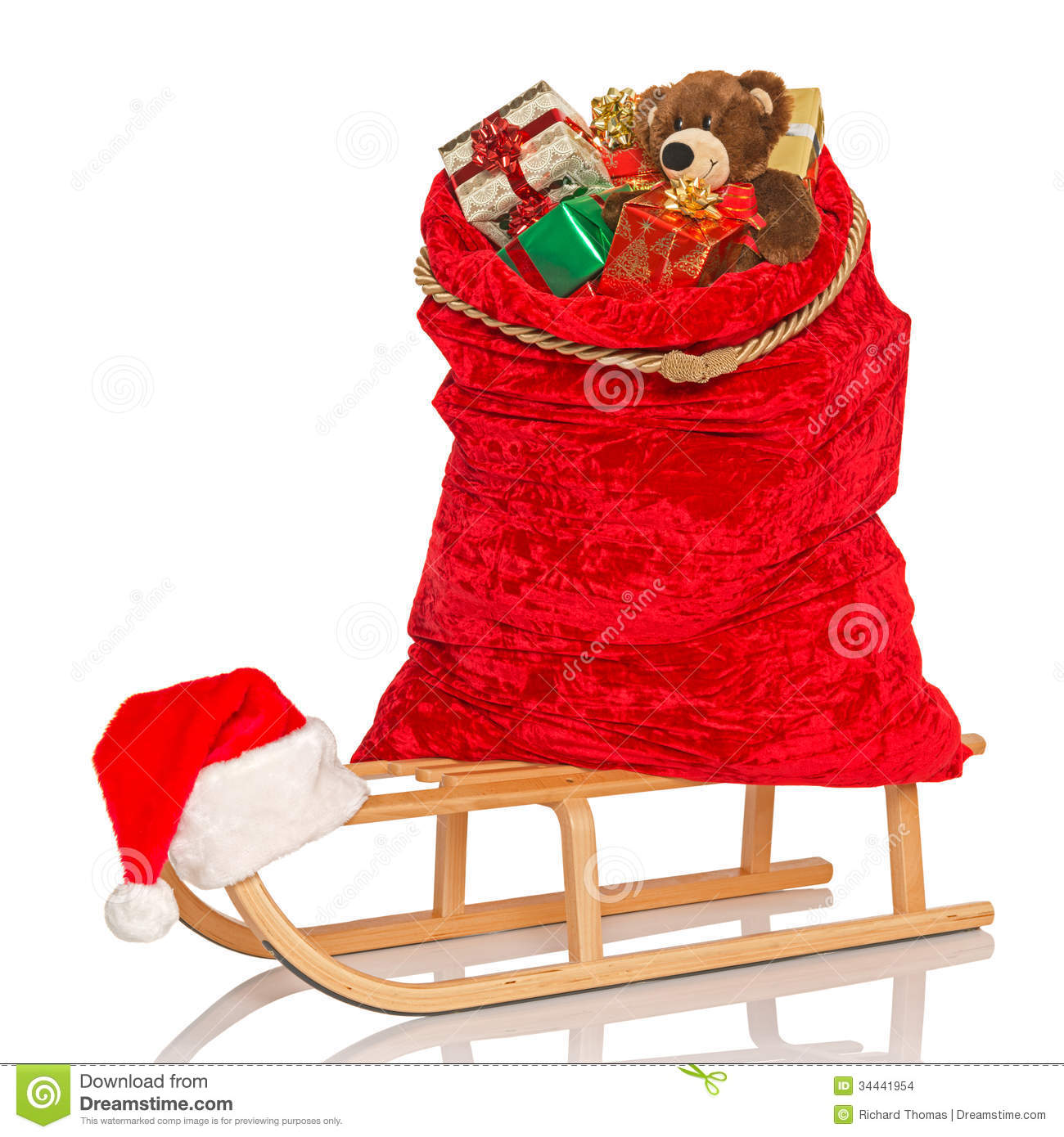 Santas Sack On Sledge Isolated Stock Images