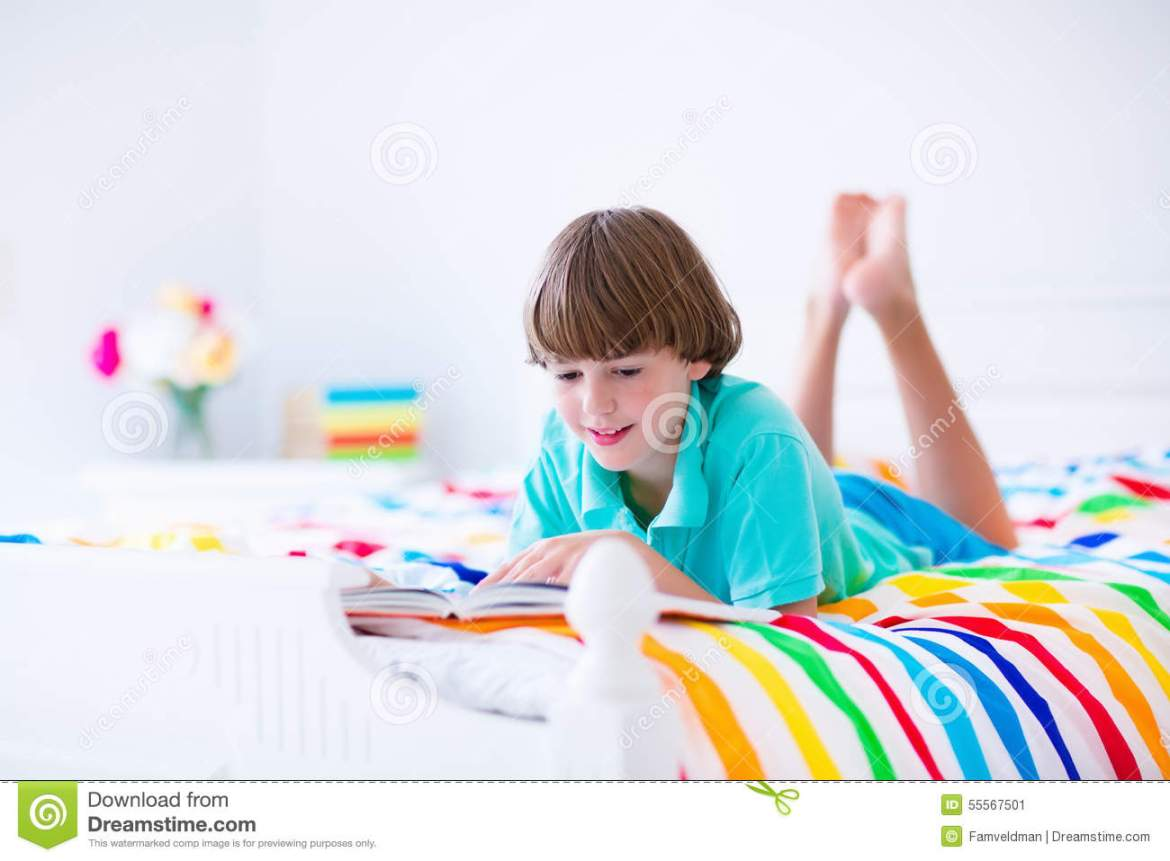 School Boy Reading A Book In Bed Stock Image - Image of ...