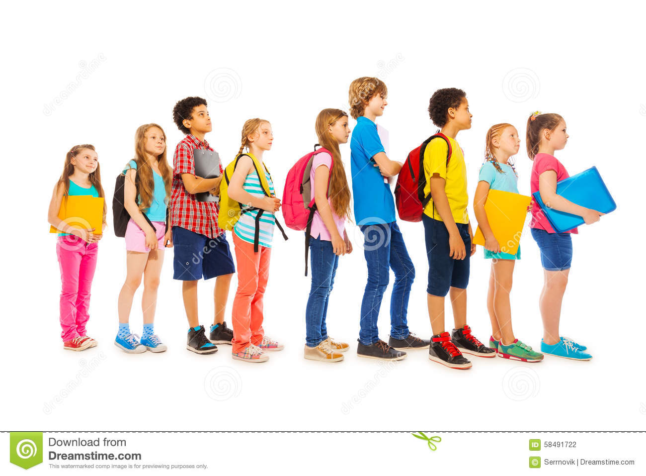School Kids With Backpacks And Textbooks Stock Photo