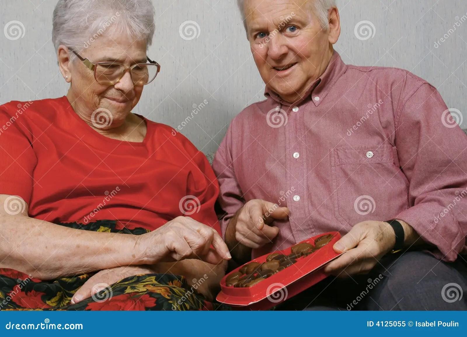 Senior Couple Eat Chocolate Royalty Free Stock Photo Image 4125055