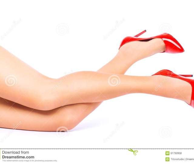 Legs In Red High Heels Isolated On White Background