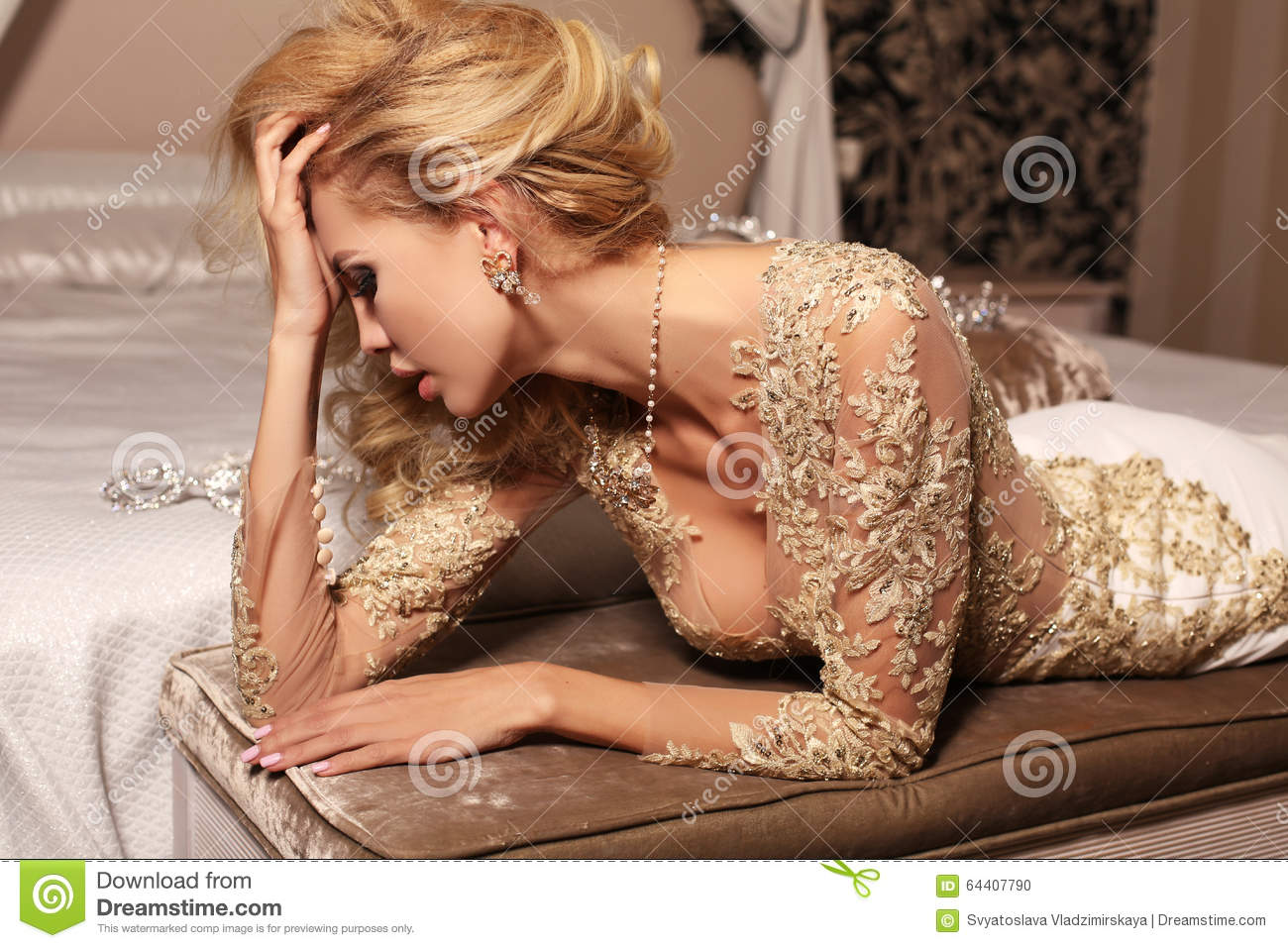 Woman With Long Blond Hair Wears Luxurios Lace Wedding