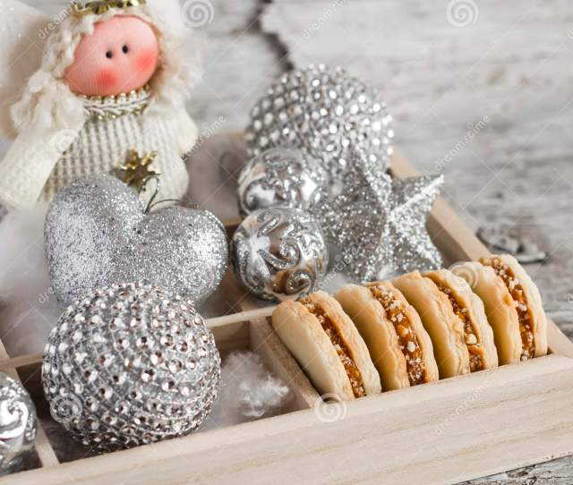 Shortbread Biscuits With Caramel Cream And Walnuts Christmas Decorations And Christmas Angel In A Wooden