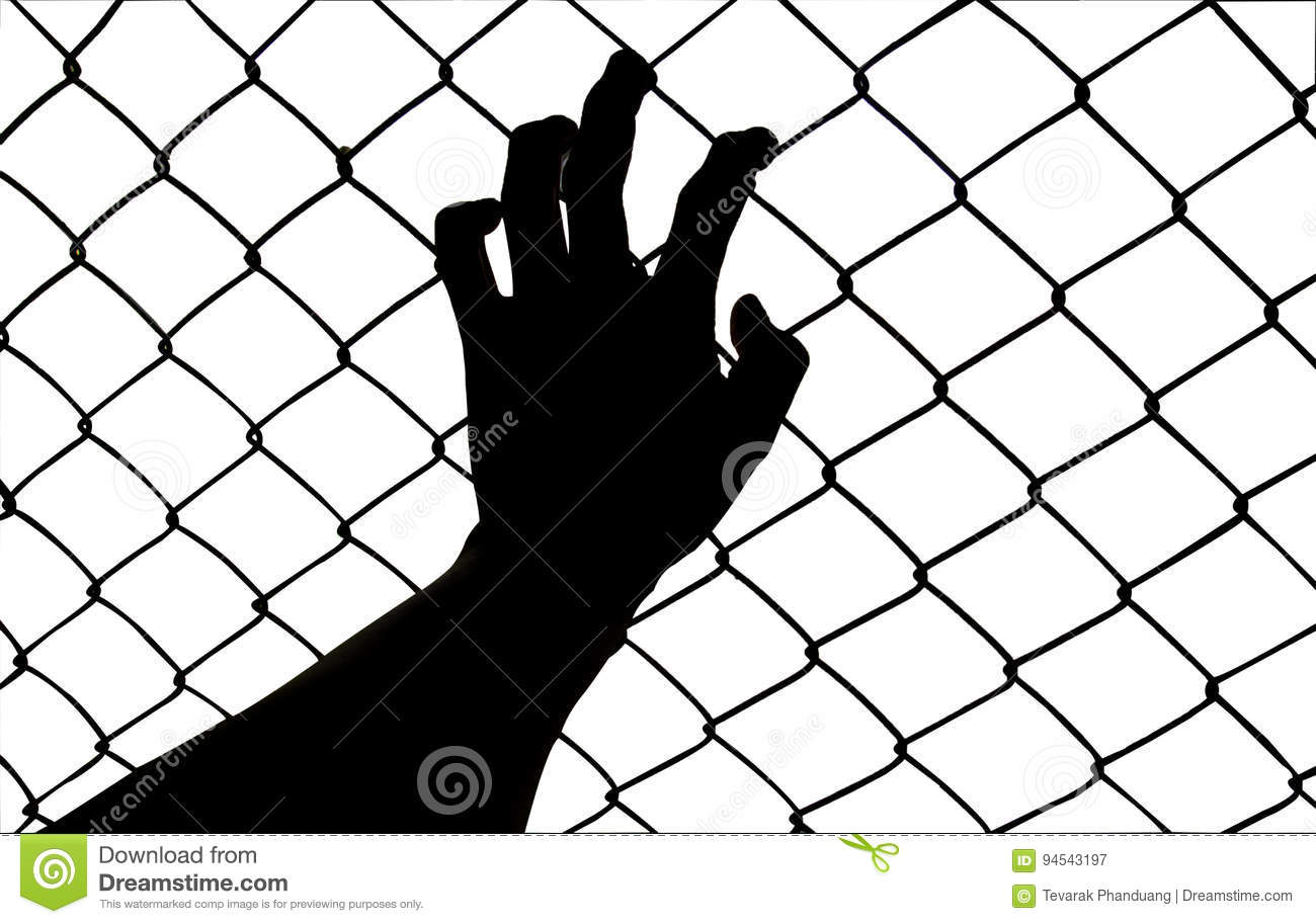 Hand On Chain Link Fence Royalty Free Stock Photo