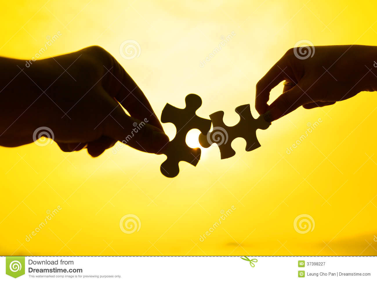 Silhouette Of Two Hands Connect Puzzle Together Stock