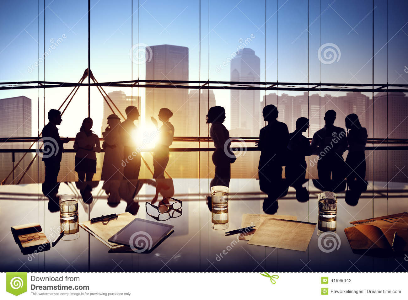 Silhouettes Of Business People Brainstorming Inside The