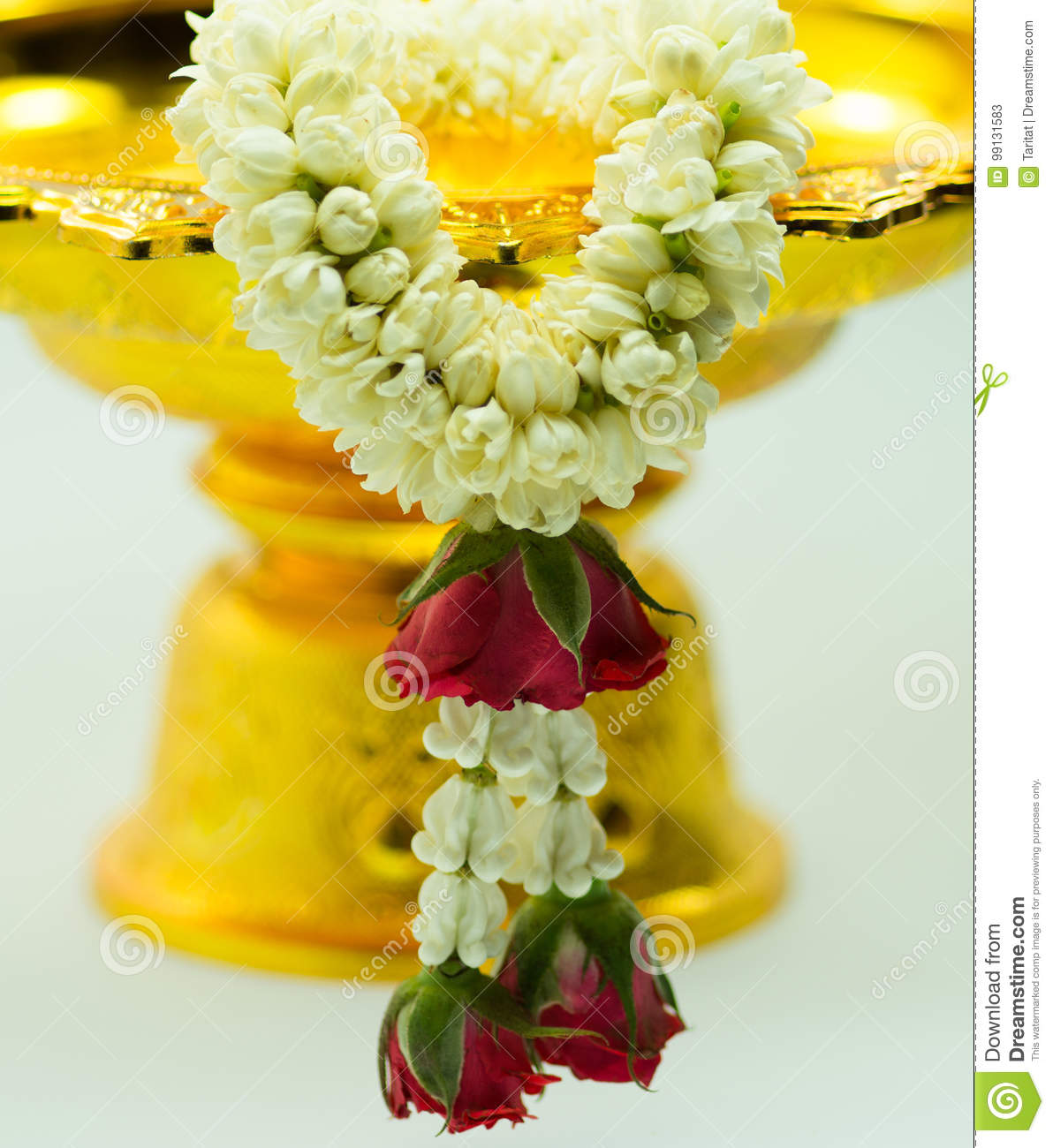 Silver And Gold Pedestal And Jasmine Garland Stock Image