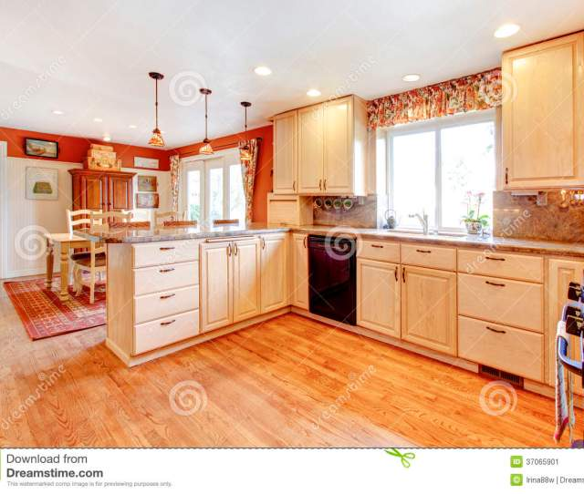 Bright Kitchen Room With Enclosed Dining Area Light Tones Furniture And Contrast Red Color Walls